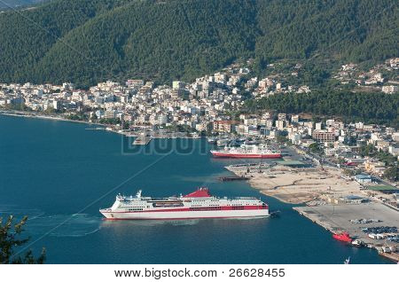 aerial view of the seacoast and the skyline of Igoumenitsa with ferry boats moored in his commercial harbor