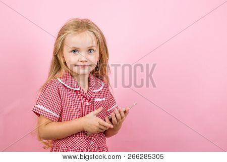 I Love To Go Shopping Online. Small Shopper Use Mobile Phone. Little Girl Shopping On Smartphone. Li