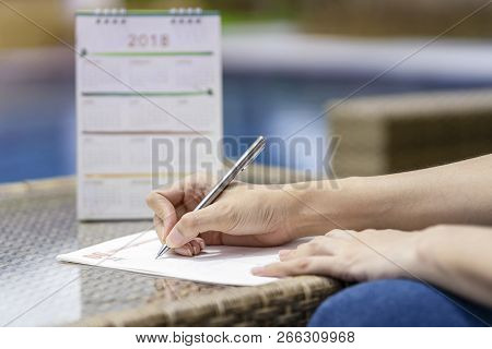 Woman Hands Writing Plan On Notebook, Planning Agenda And Schedule Using Calendar Event Planner On D