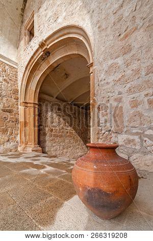 Typical and traditional Alentejo ceramic pottery of red clay from Crato in the entrance of Mosteiro de Santa Maria de Flor da Rosa Monastery. Crato, Portugal