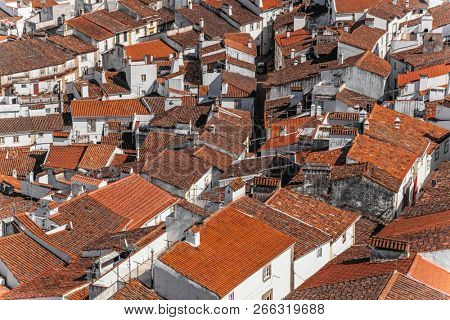 View of a typical village of Alentejo with the sinuous streets, white washed walls and red orange rooftops. Castelo de Vide, Alto Alentejo, Portugal