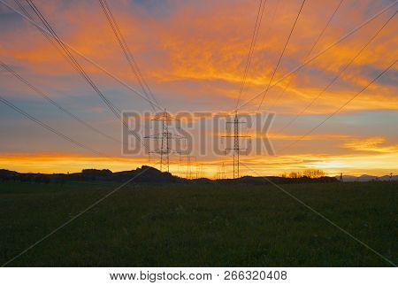 220 Kilovolt And 380 Kilovolt Electric Power Pylons At Dawn - 6 Phases And One Ground Wire