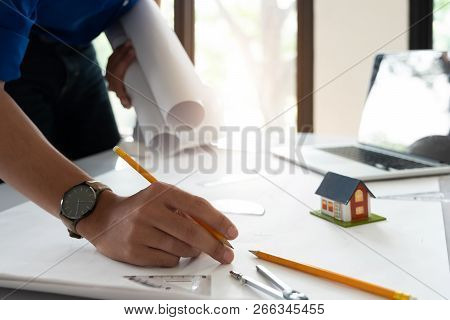 Image Of Engineer Drawing A Blue Print Design Building Or House, An Engineer Workplace With Blueprin