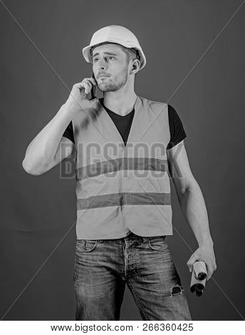 Architect Calling Engineer To Fix Plan. Communication Concept. Man, Foreman In Helmet Speaking On Ph