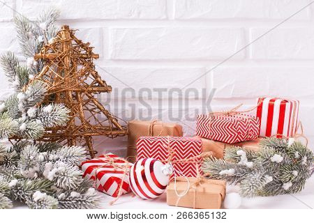 Christmas And New Year Decorations. Decorative Fur Tree, Wrapped Christmas Presents, Fur Tree Branch
