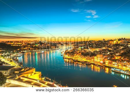 Oporto Cityscape Reflecting On Douro River At Twilight. Porto Is The Second Portugals Largest City.