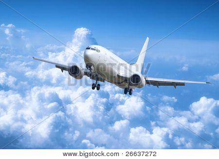 Big jet plane above clouds