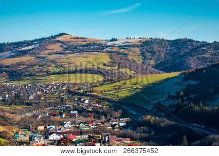 Village In A Valley. November Weather. Grassy Rural Fields On Hills Above Settlement. Lovely Sunny D