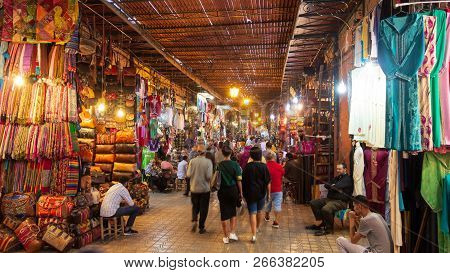 Marrakesh, Morocco - Apr 28, 2016: Tourists And Local People Walking Through The Shopping Souks In T