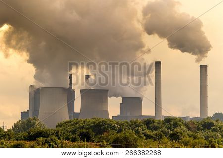 Large Brown Coal Power Plant Chimney Emission.