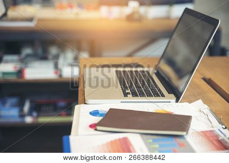 Business Computer Office Desk With Desktop Laptop,notebook,pen And Annual Reports,summary Report,doc