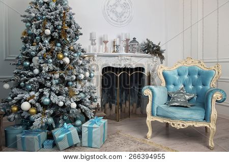Beautiful Holiday Decorated Room With Christmas Tree With Presents Under It. Christmas And New Year