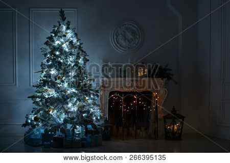 Living Room With A Fireplace And A Large Christmas Tree With Gifts And Light Flash