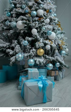 Bunch Of Festive Boxes With Gifts Under The Christmas Tree. New Year Home Decoration