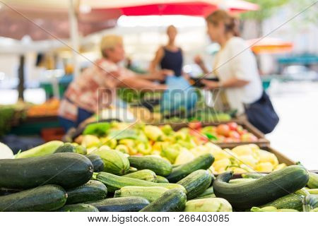Blured Unrecodnised People Buying Homegrown Vegetable At Farmers Market Stall With Variety Of Organi
