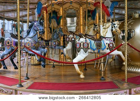 Retro Carousel With Colorful Horses And Lights.