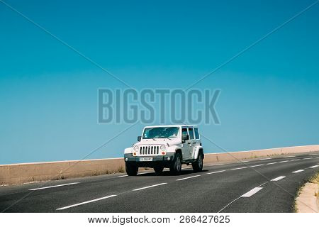 Collioure, France - May 16, 2018: White Jeep Wrangler Jk Drive In Mountains Road. Third Generation O