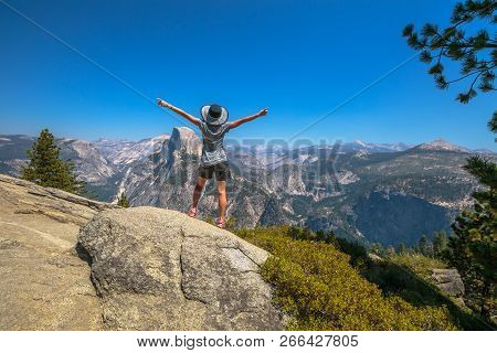Travelling Enthusiast Woman Happy For The Glacier Point Aerial View In Yosemite National Park, Calif