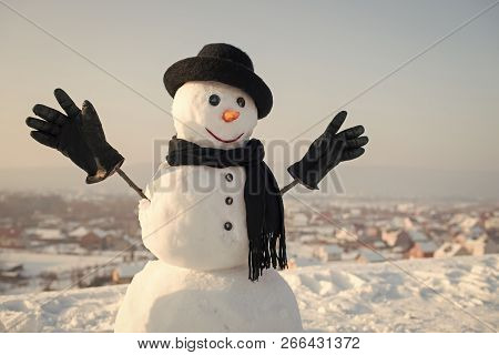 Snowman Gentleman In Winter Black Hat, Scarf And Gloves. Xmas Or Christmas Party. New Year Snowman S
