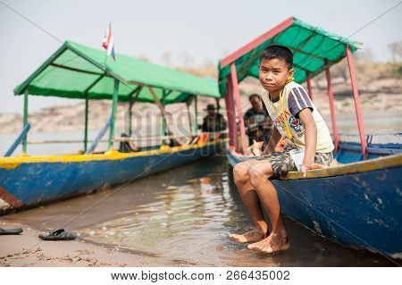 Champasak, Laos - February 26 : Unidentified Children Seating And Fun Relax At Boat On February 26,