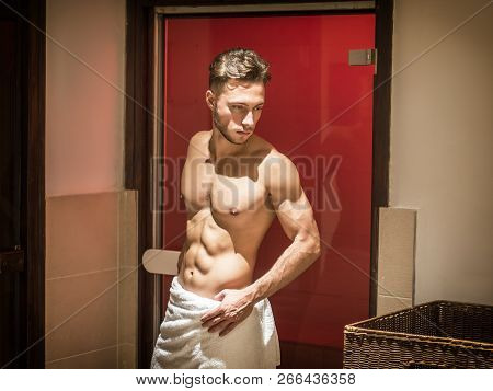 Young Man Relaxing In Sauna, Going Out