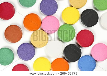 Watercolor Tablets On White Randomly Arranged For Backgrounds