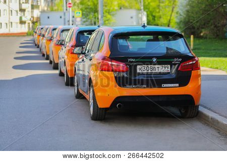 MOSCOW - MAY 8, 2018: Back of seven BMW cars are on asphalt on sunny street for carsharing, Moscow carsharing company You drive