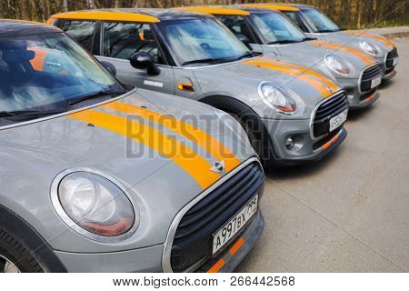 MOSCOW - APR 29, 2018: Four BMW mini cars of Moscow carsharing company You drive in park, carsharing is system of short-term car rental with per minute payment