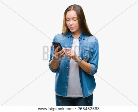 Young beautiful caucasian woman texting sending message using smartphone over isolated background with a confident expression on smart face thinking serious