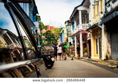 Focus At Sideview Mirror Of A Car In Phuket Old Town. Rommanee Street.