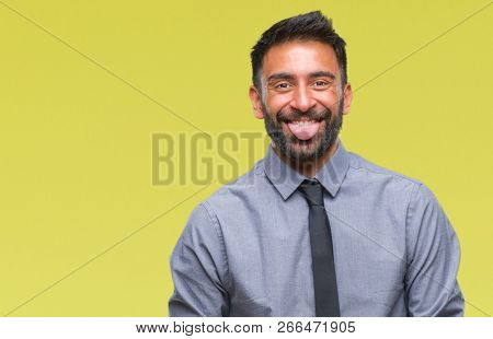 Adult hispanic business man over isolated background sticking tongue out happy with funny expression. Emotion concept.