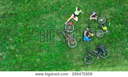 Family Cycling On Bikes Outdoors Aerial View From Above, Happy Active Parents With Child Have Fun An
