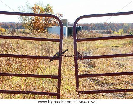 Oil barrels behind a closed gate