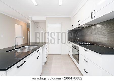 Modern Kitchen Design With Stone Bench Top And Contrasty Colour Scheme. Australian Interior Design.