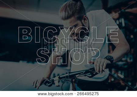 Bicycle Shop. Man Riding On Bicycle. Guy Checks The Bike. Man Looking On His Bicycle. Young Beard Ma