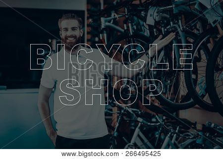 Bicycle Shop. Salesman Showing The Bicycles. Young Beard Man. Hipster Man Happy And Smiling. Man Loo