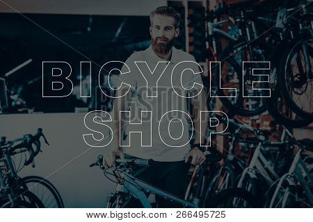 Bicycle Shop. Salesman Holding The Bicycle. Young Beard Man. Hipster Man Happy And Smiling. Man Look