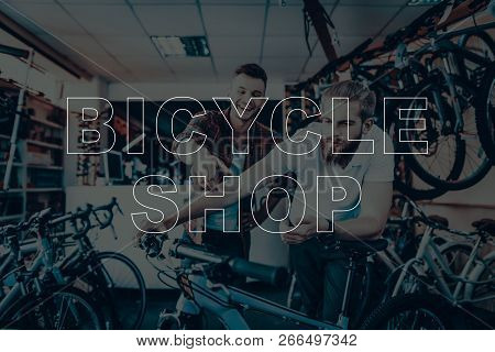 Bicycle Shop. Salesman Showing Bicycle To Customer. Customer Choosing The Bicycle. Hipster Male Sale