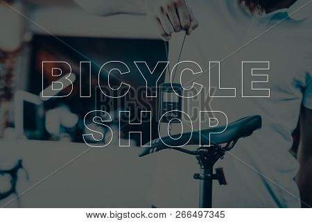 Bicycle Shop. Salesman Holding Weights For Bicycle. Salesman Weighting A Bike. Modern Bicycle Under