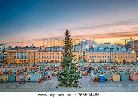 Helsinki, Finland. Christmas Xmas Market With Christmas Tree On Senate Square In Sunset Sunrise Even