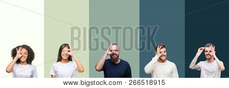 Collage of group of young people over colorful isolated background doing ok gesture with hand smiling, eye looking through fingers with happy face.