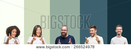 Collage of group of young people over colorful isolated background pointing fingers to camera with happy and funny face. Good energy and vibes.