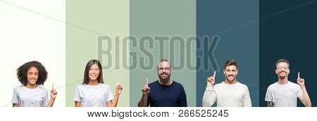 Collage of group of young people over colorful isolated background showing and pointing up with finger number one while smiling confident and happy.
