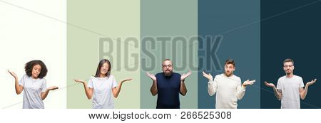 Collage of group of young people over colorful isolated background clueless and confused expression with arms and hands raised. Doubt concept.