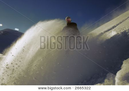 Snowboarder With Cloud Of Snow