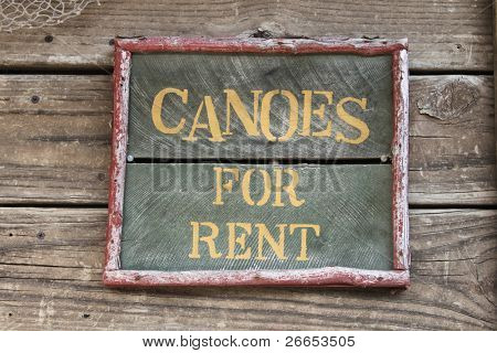 Canoes for rent sign