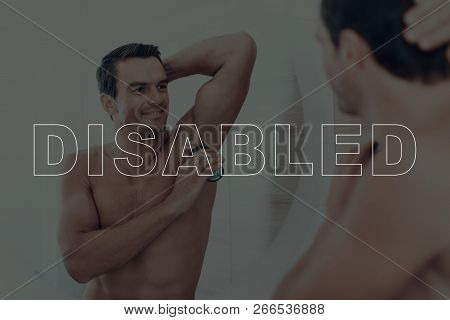Disabled Man. Man Looking At Himself In The Mirror. Man Is Happy And Smiling. Man Is Using A Deodora