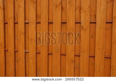 Brown Wooden Planks Texture On The Wall Of The Fence