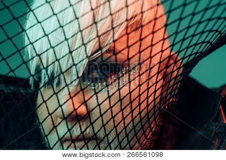 Get the freak up. Male makeup look. Transgender man cover face with fishnet. Fetish fashion. BDSM fashion accessory. Heterosexual man with male makeup. poster