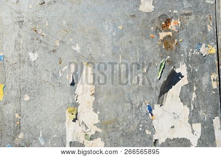 Corroded Sheet Metal Background With Remains Of Posters